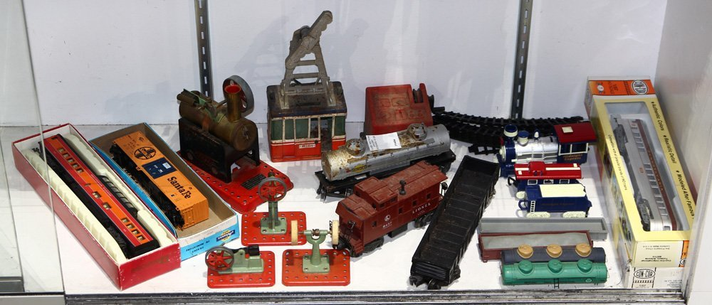 One shelf of assorted model trains, motors, and