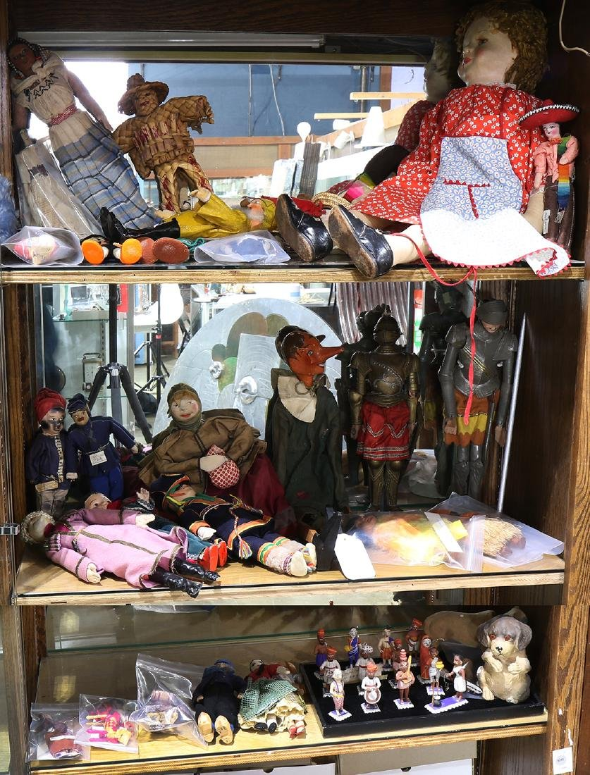 Three shelves of toys and dolls, including French,