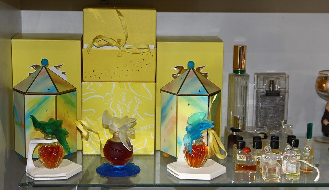 Perfume bottle group, including three Nina Ricci, Paris