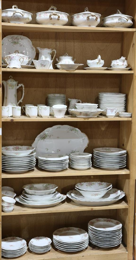 Six shelves of French Limoges dinner service