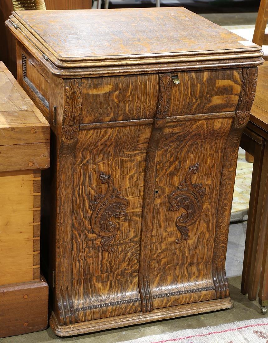 New Home sewing machine, housed in a quartersawn oak