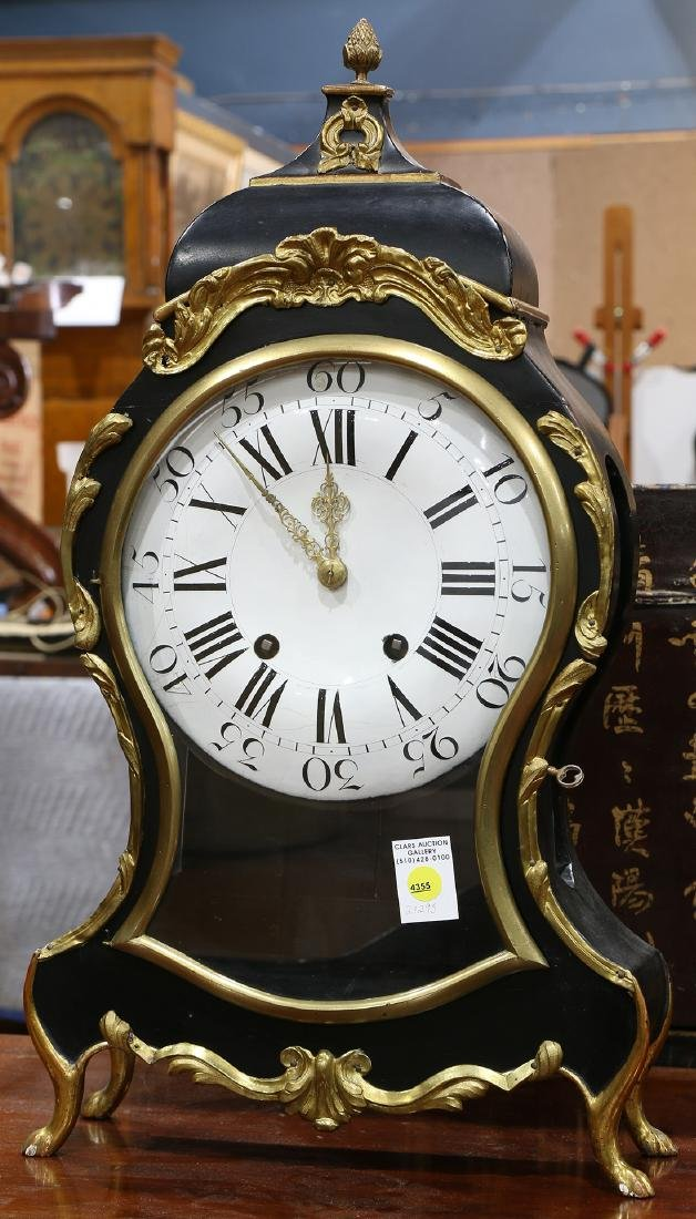 Louis XV style bracket clock, having a shaped ebonized