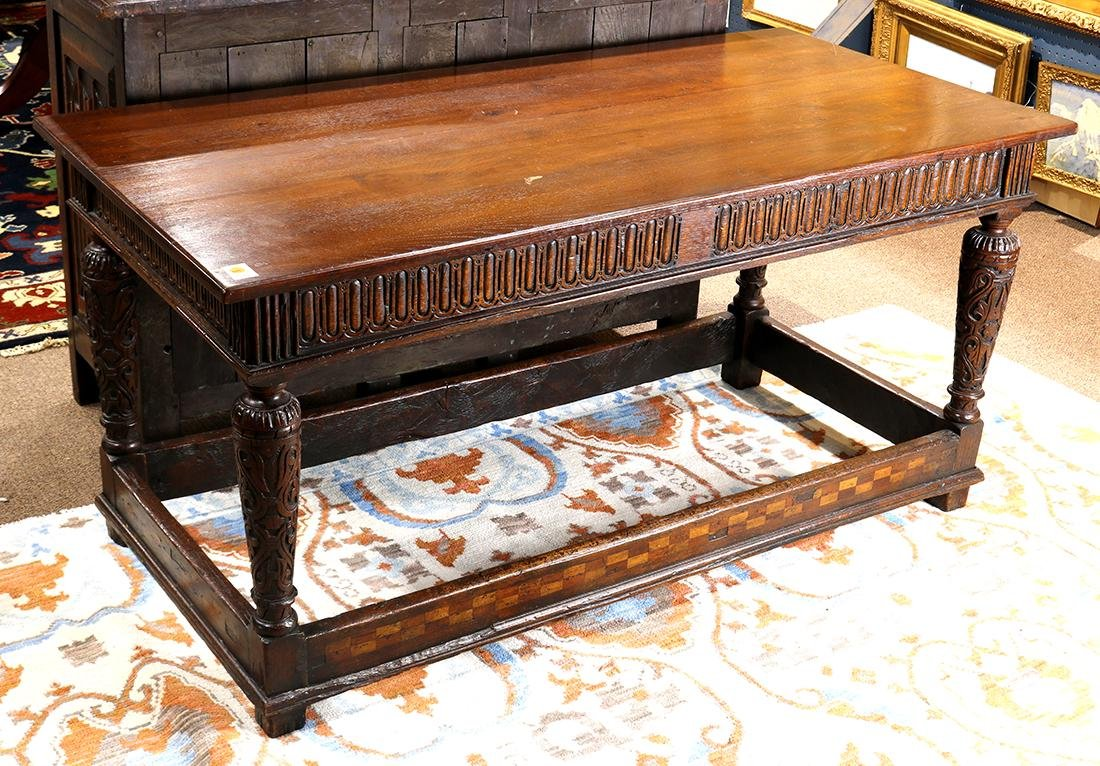 Continental carved and inlaid refectory table, having a