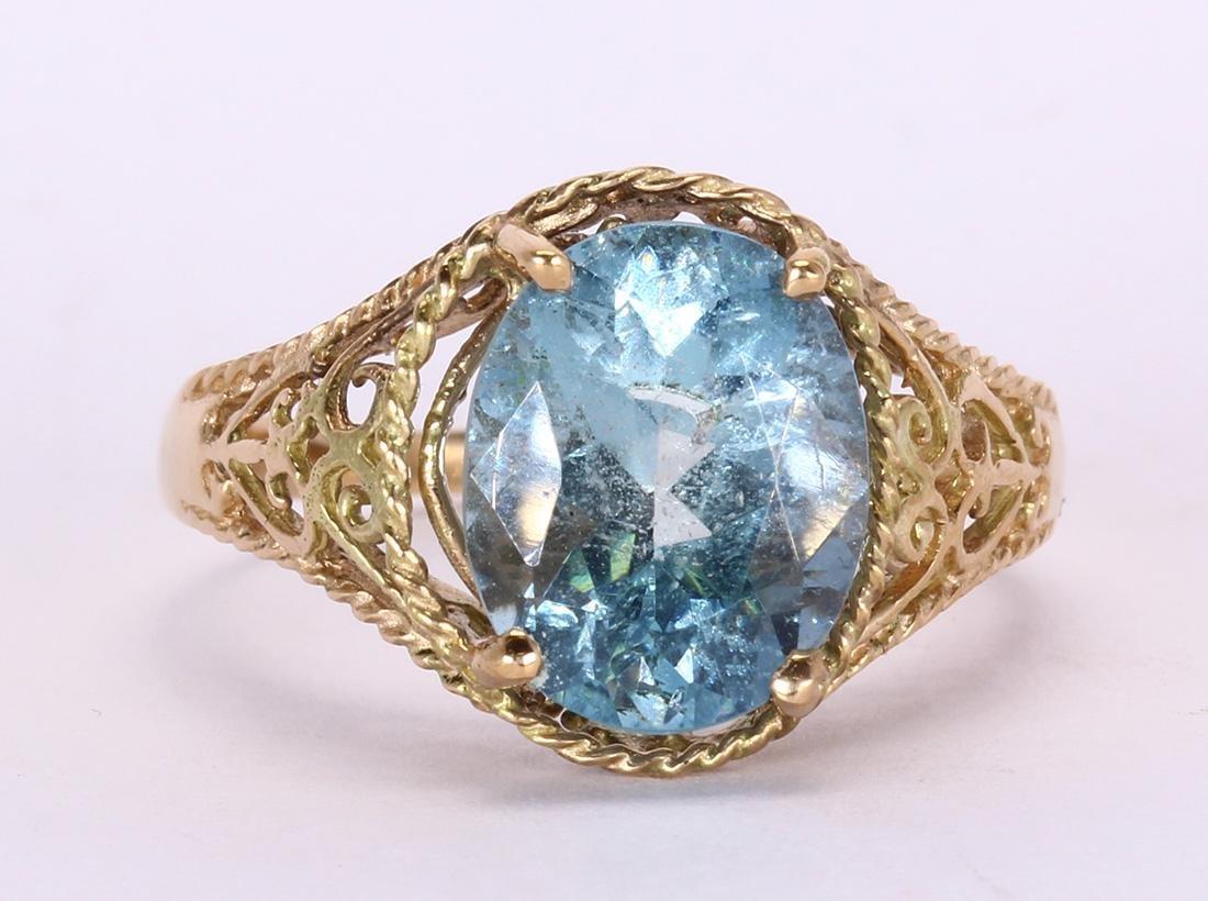 Aquamarine and 14k yellow gold ring