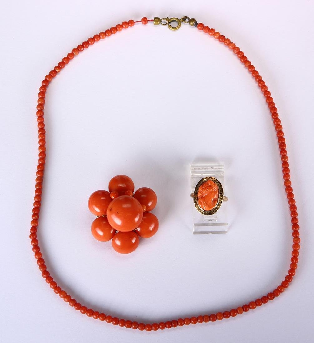 Coral, yellow gold and metal jewelry suite
