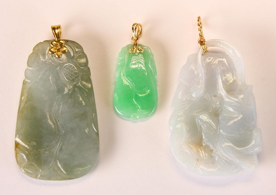 Jadeite, yellow gold and metal pendants