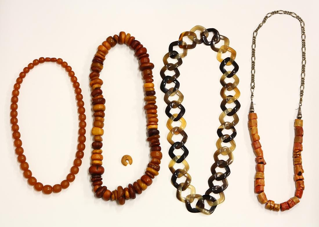 Amber, coral, horn and metal necklaces