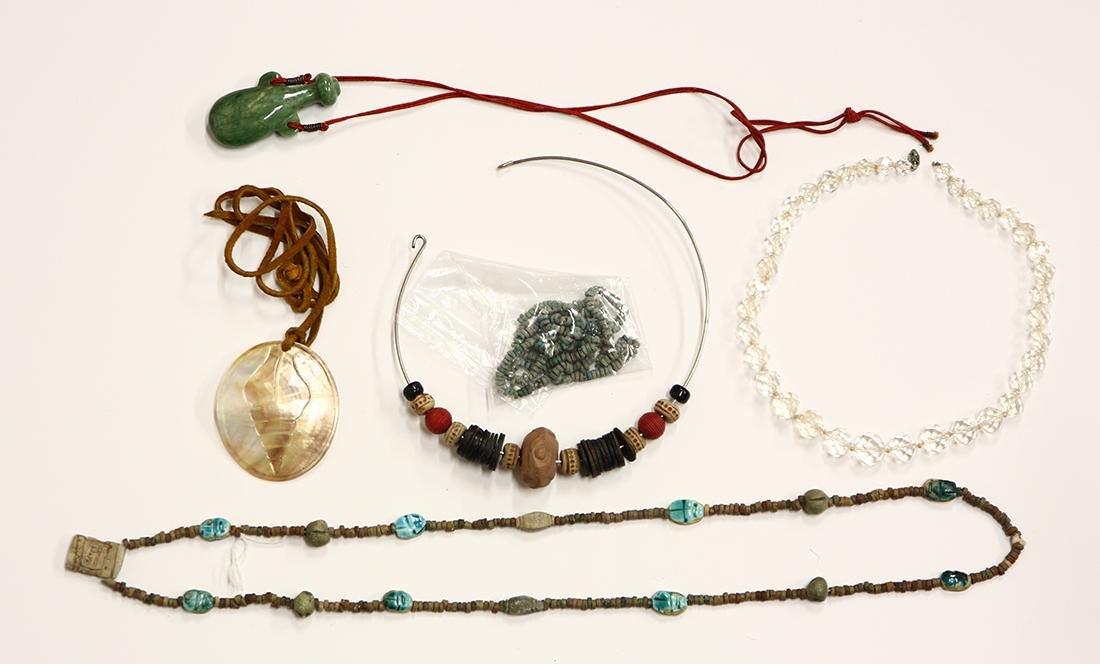 Jade, rock crystal quartz, shell Faience, clay and