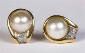 Pair of mabe pearl diamond and 14k yellow gold