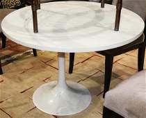 Saarinen style tulip table, the round top rising on a