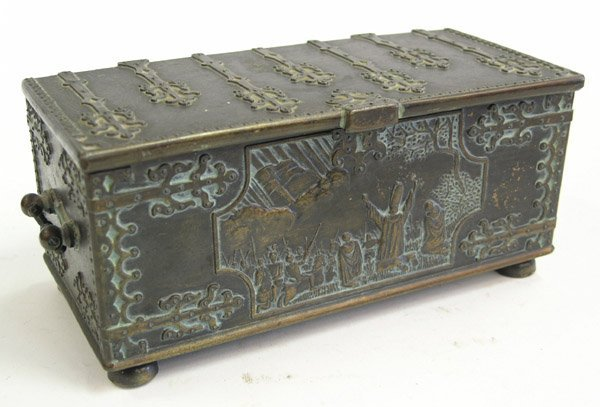 23: Arts and Crafts style brass casket