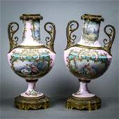 Pair of Sevres style porcelain scenic urns