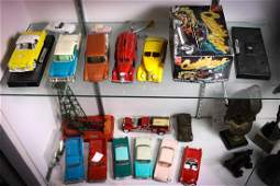 Two shelves of die cast and plastic model cars