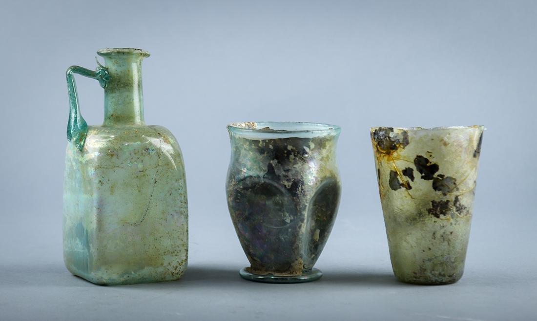 Ancient Roman iridescent blown glass vessels group,
