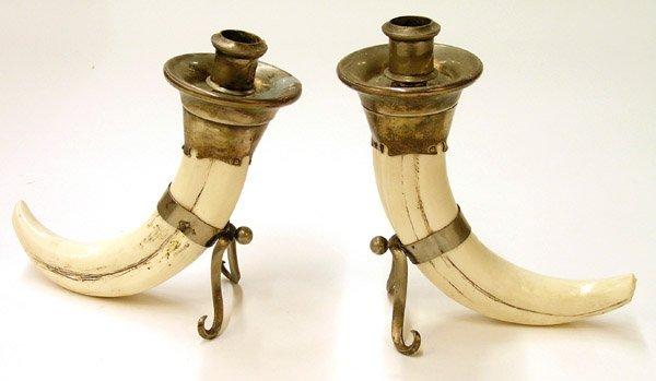 6017: Faux boar's tusk candlesticks