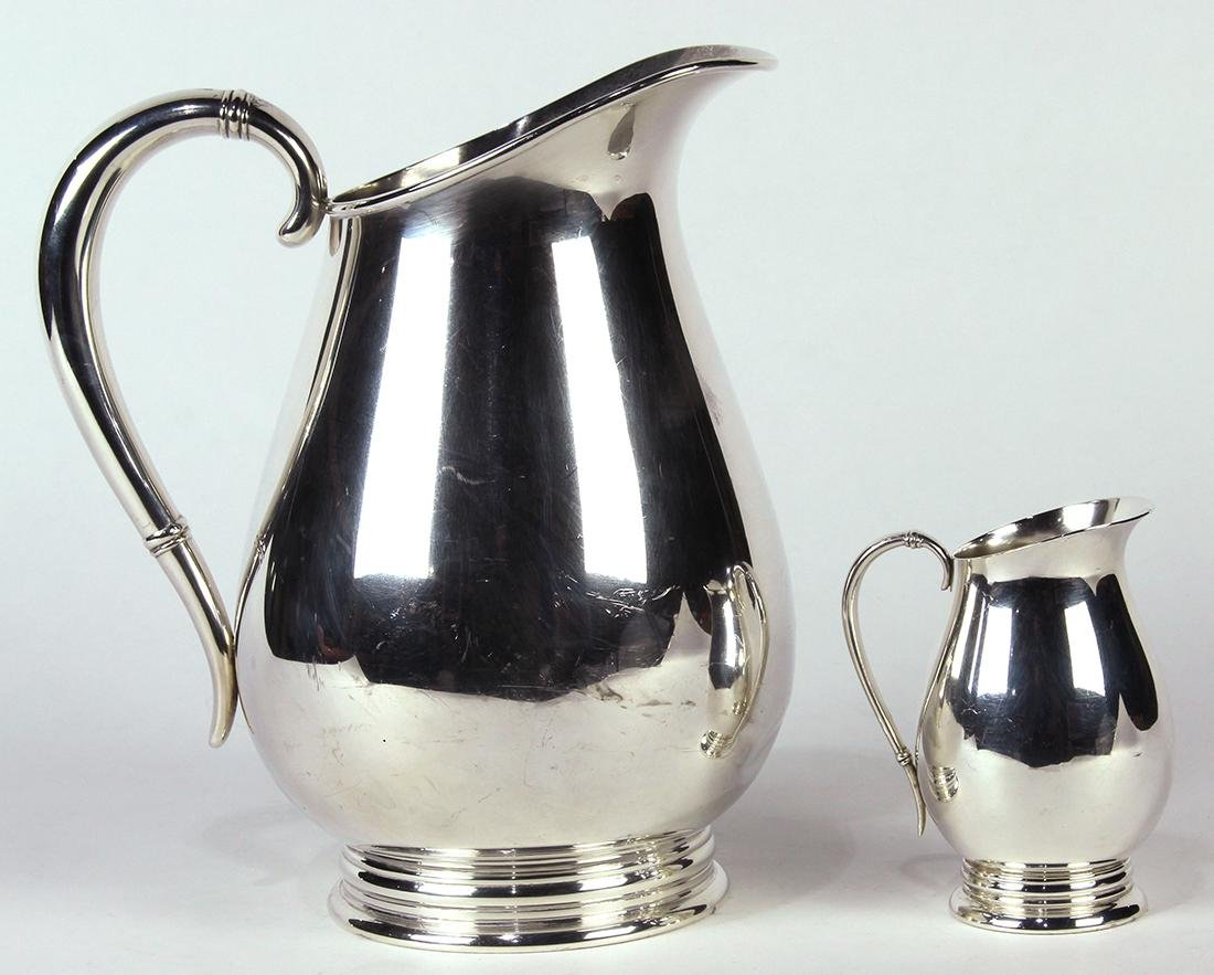 International sterling silver pitcher group, 20th