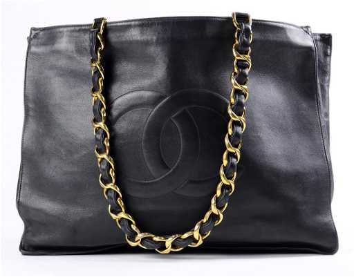 4fdc8d908a1629 Chanel black leather tote bag. placeholder. See Sold Price