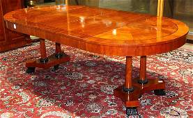 Empire style dining table by Baker Furniture Co