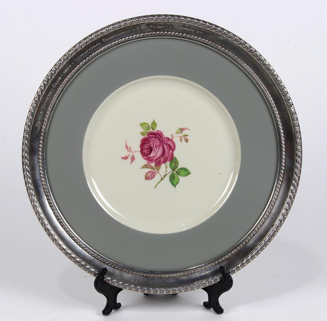 Sterling silver and porcelain charger, having a
