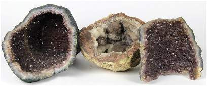 Geode rock specimen group, including crystal and