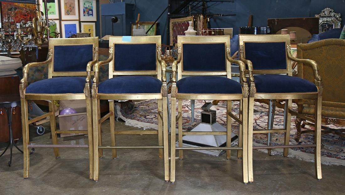 Regency style giltwood bar stools, having an