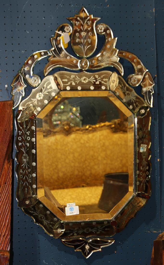 Venetian style mirror, having a bevelled and floral