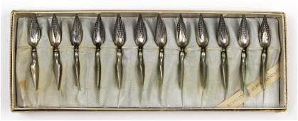 (lot of 12) American sterling silver corn holders,