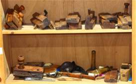 Two shelves of assorted antique wood working tools,