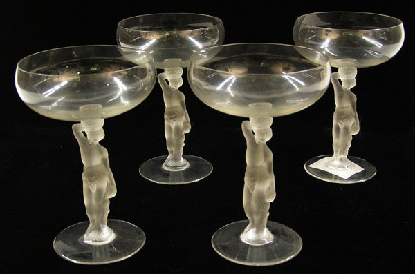 19: Crystal champagnes figural stems