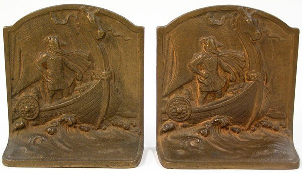 21: bronze bookends with Viking motif