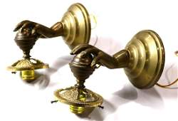 Pair of Italian brass figural wall sconces executed in