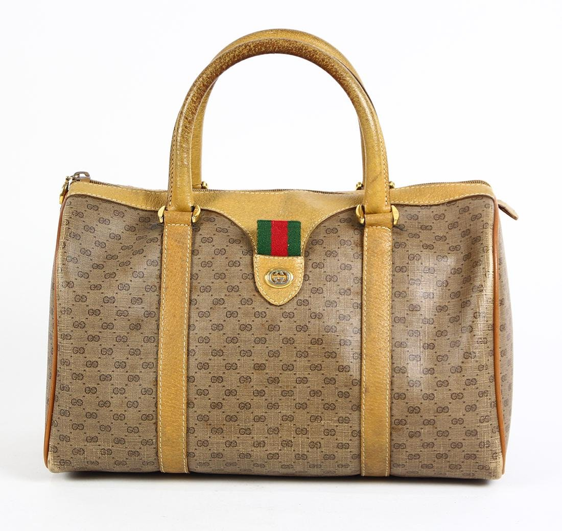 37db1749d7 Gucci monogrammed canvas handbag, having a zipper - May 18, 2019 | Clars  Auction Gallery in CA