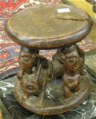 229 African carved wooden figural stool