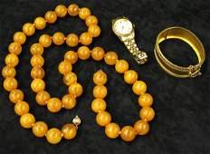 565 14k gold cuff bracelet amber necklace