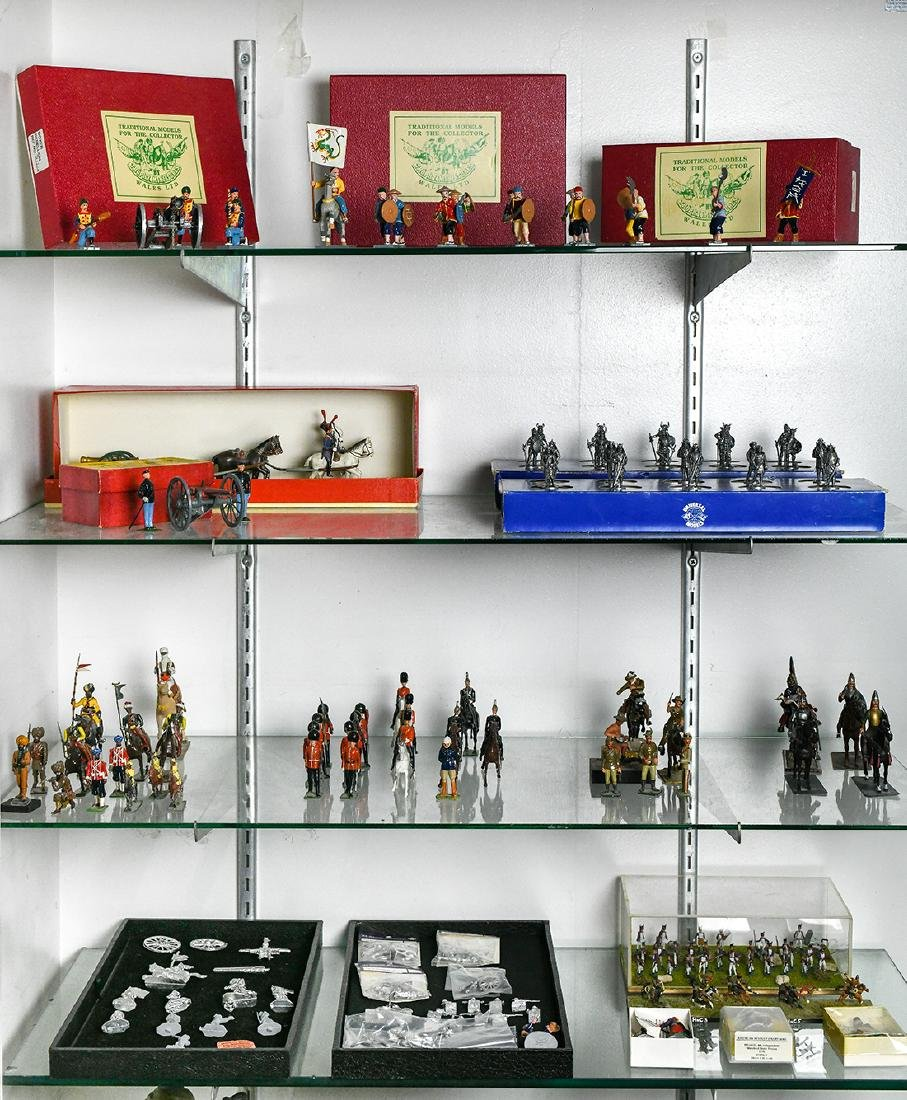 Four shelves of toy soldiers