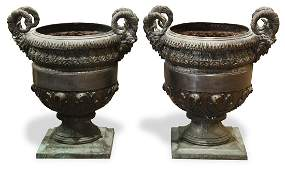 Pair of patinated bronze garden urns
