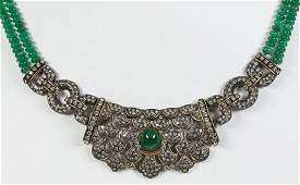 Emerald, diamond, blackened, gilted silver and 14k