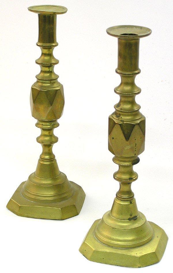 23: Adjustable brass candlesticks Diamonds.Adjustable b
