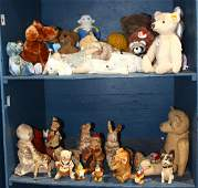 Two shelves of stuffed animals and dolls, including