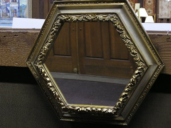 Carved hexagonal wall mirror