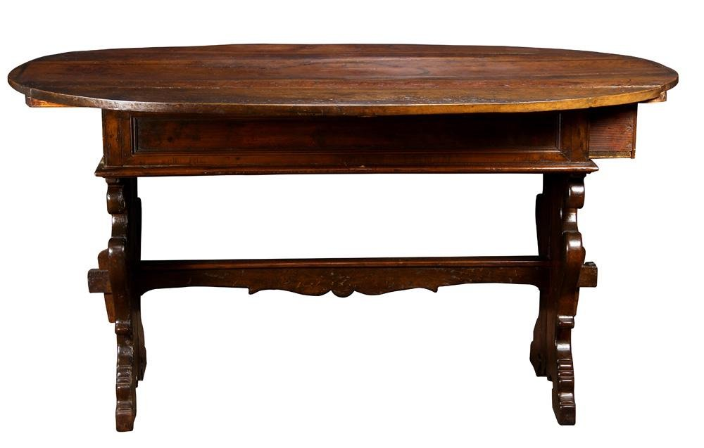 A French Provincial oak trestle table