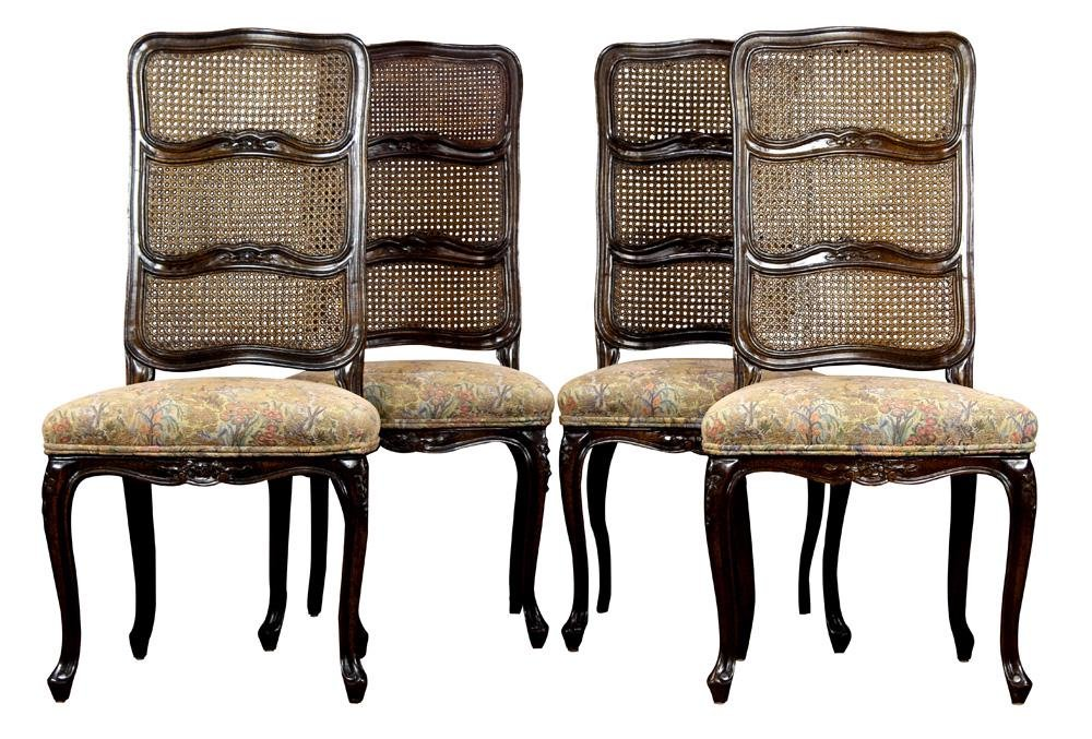 A set of French Provincial style caned oak chairs