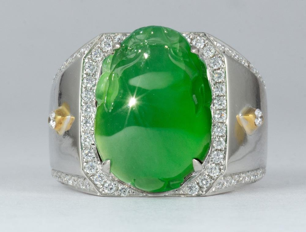 Carved jadeite, diamond, 18k gold ring