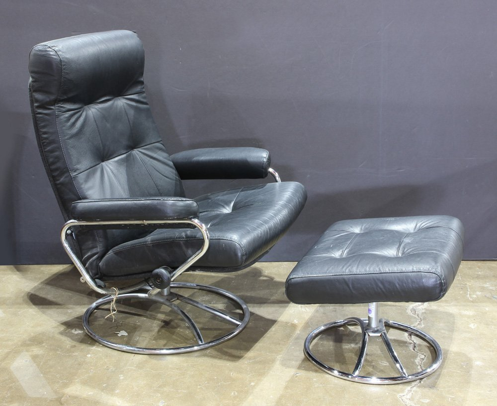 A contemporary black leather and chrome lounge chair