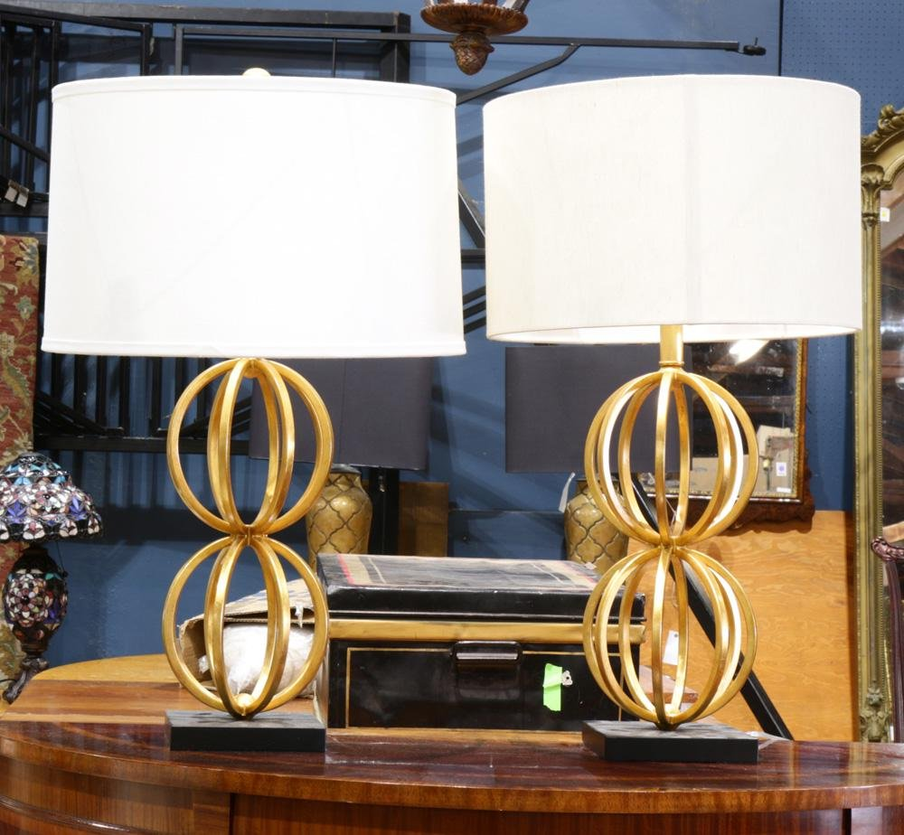 A contemporary pair of lamps, each having gilt double