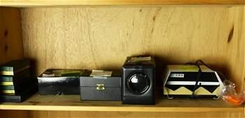 A shelf of mostly gemological equipment