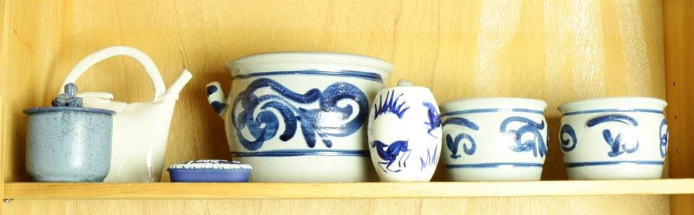 A shelf of blue and white pottery articles