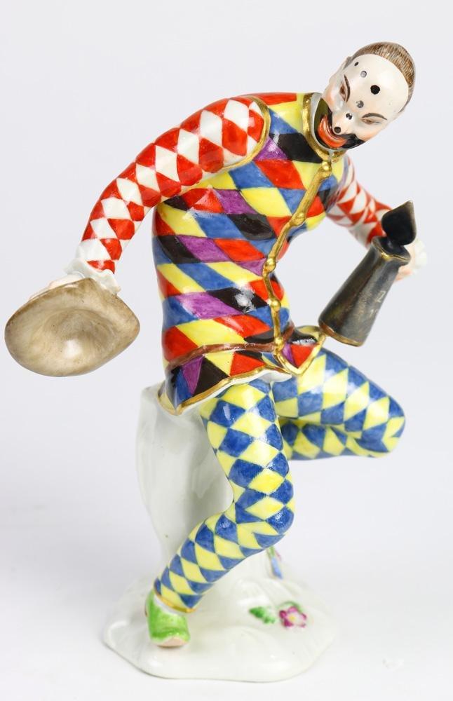A finely enameled Meissen porcelain Harlequin after a