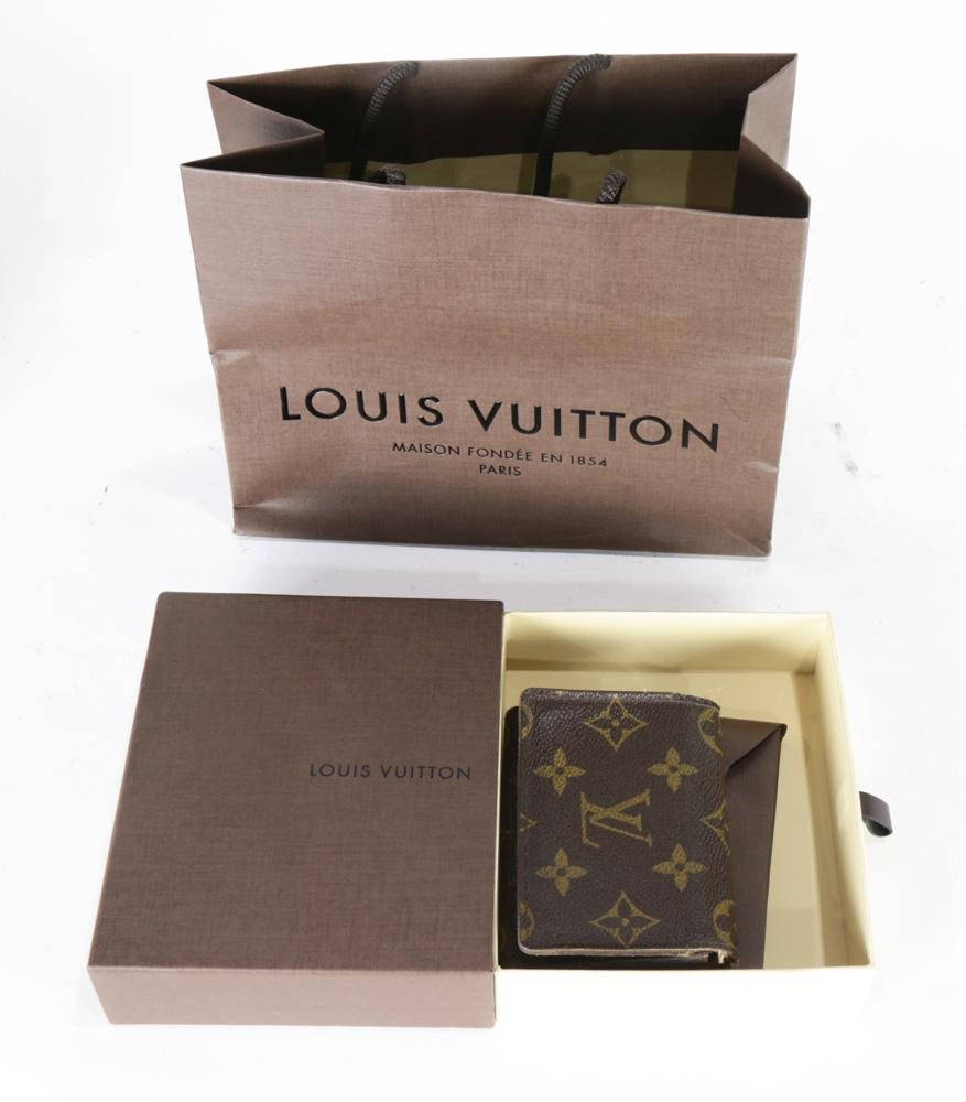 A Louis Vuitton wallet with original bag and box