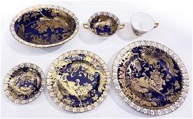 A Royal Crown Derby porcelain service in the Gold Aves